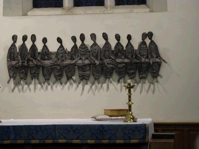 representation of the last supper behind the altar